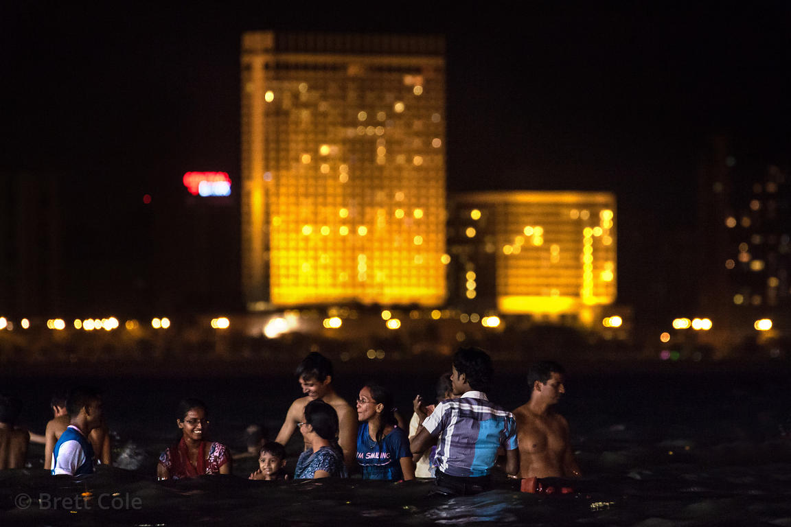 Families immerse statues of Ganesh into the Arabian Sea at night during the Ganesh Chaturthi festival, near Chowpatty Beach, ...