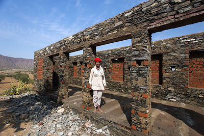 Pujari tends to a temple under construction, Chainpura village, Rajasthan, India