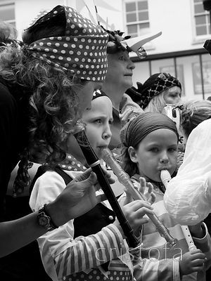 an unhappy young recorder player in the Golowan Festival Mazey Day parade