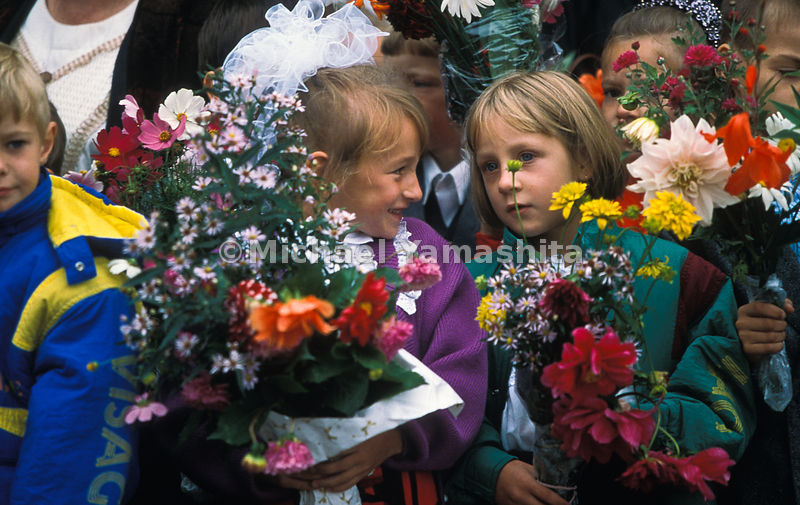 Flowers bloom from the hands of students on the first day of school on Kunashir. After the 1994 earthquake, which crumpled fa...