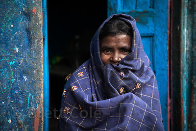 Woman in blue, Howrah, India