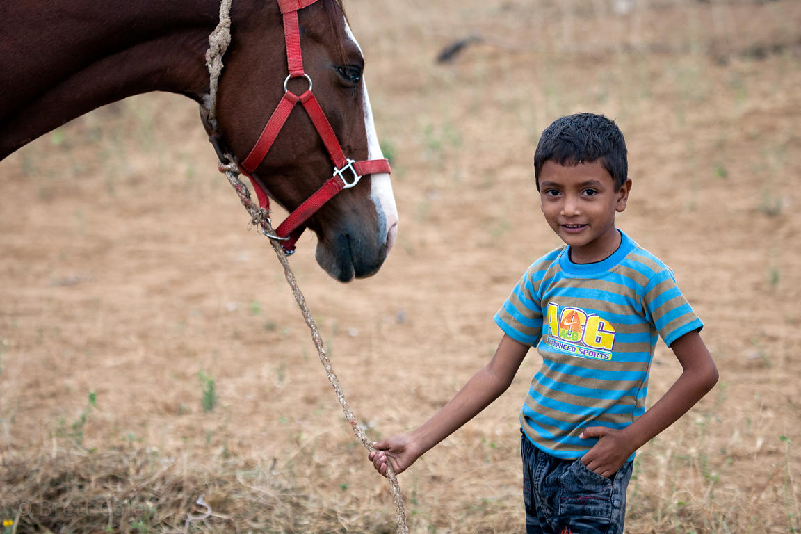 A boy and his horse in Pushkar, Rajasthan, India