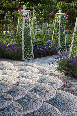 'A Beekeeper's Garden' at RHS Hampton Court Flower Show. Designer: Nicola Hills and Jonathan Denby. © Rob Whitworth