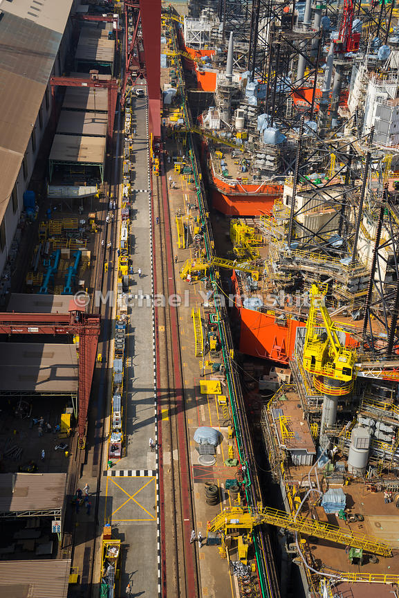 Jackup rigs built to Keppel's proprietary KFELS B Class design are lined up along the drydock. The process of assembling rigs...