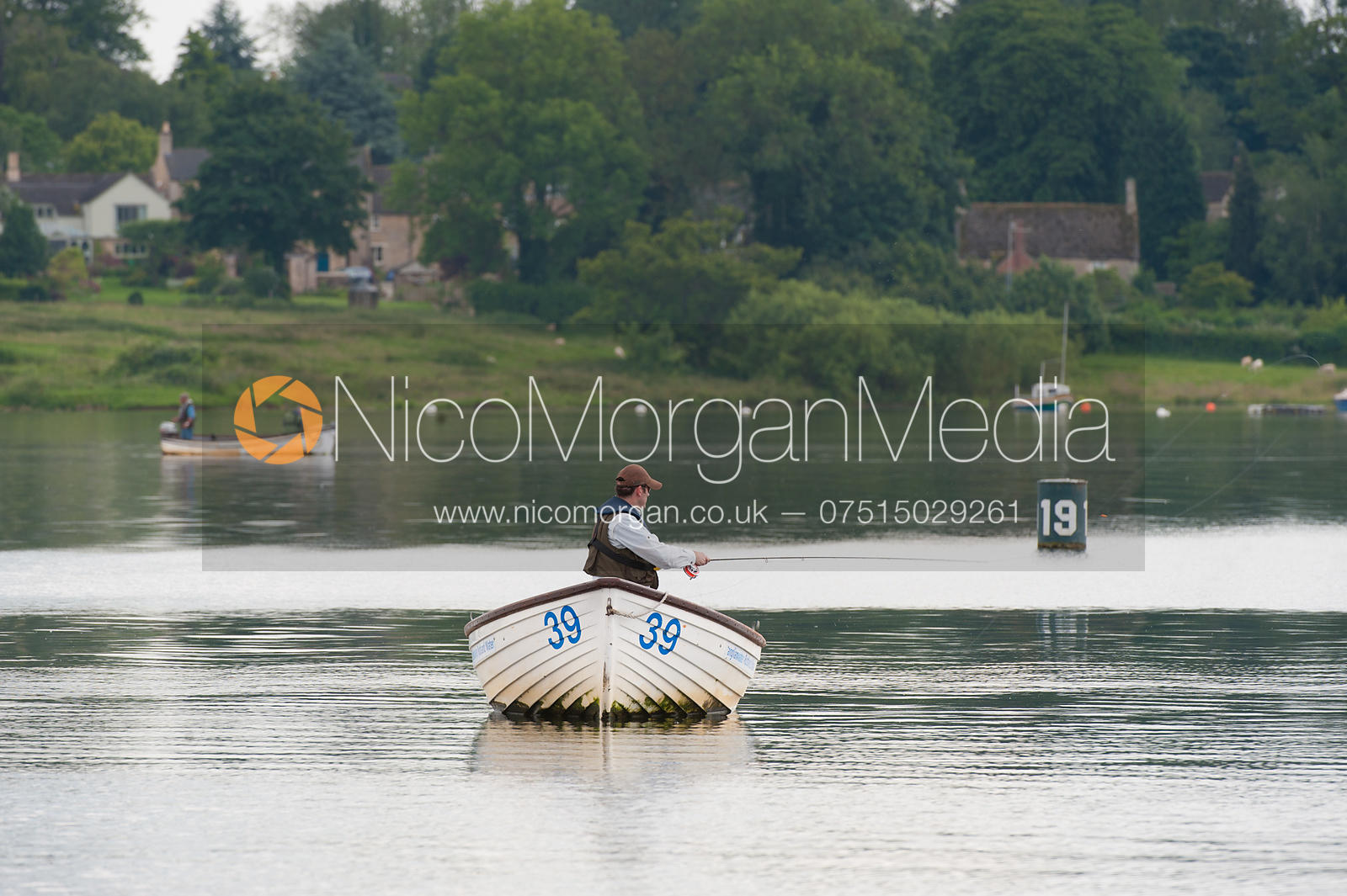Single fisherman fly fishing from a boat on Rutland Water