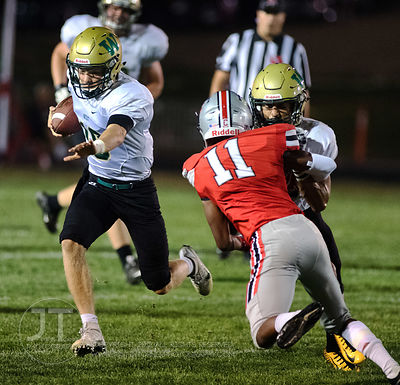 Iowa City West's Evan Flitz (10) runs past Iowa City High defenders during the first half of play at Frank Bates Field in Iow...