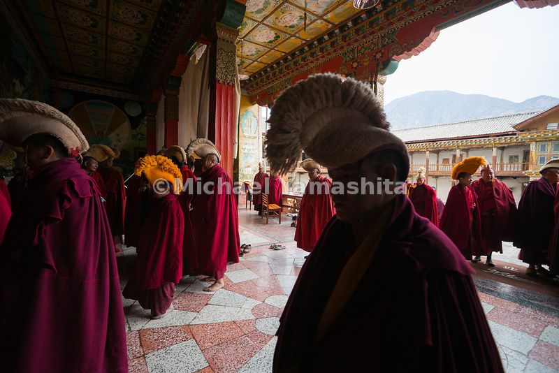 Buddhist monks of the yellow hat sect file into the centuries-old Dongzhulin Monastery, which sits near the scenic mountain v...