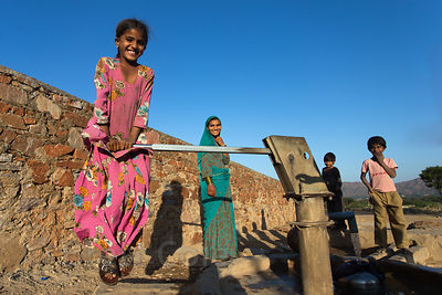 Children pump water near a school in Kharekhari village, Rajasthan, India