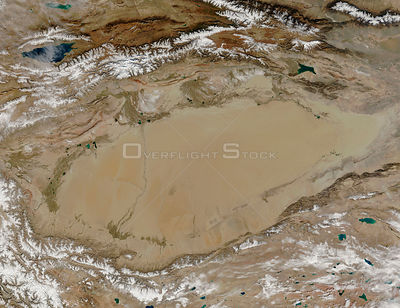 EARTH Taklamakan Desert -- 2005 -- The entire Taklamakan Desert is visible in this MODIS image. Covering a large swathe of Ce...