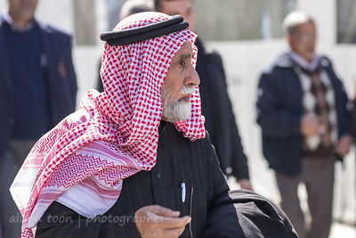 Man with red and white Arabic headdress