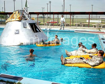 (June 1966) --- Prime crew for the first manned Apollo mission practice water egress procedures with full scale boilerplate m...