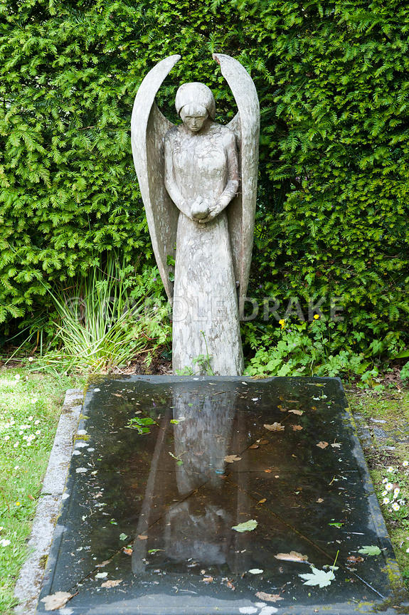 Water feature in slate and granite by Mathew Robinson, overlooked by yew wood angel carved by John Aulman. Caervallack Farm, ...