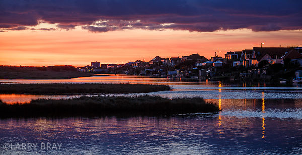 Sunset at tidewater in Shoreham-by-Sea, West Sussex, UK