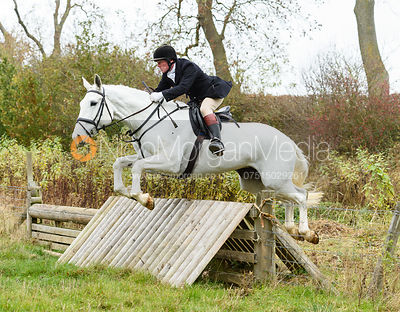 Dick Wise jumping a hunt jump near Peake's. The Cottesmore Hunt at Somerby