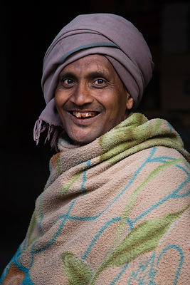A man smiles revealing teeth heavily stained by chewing tobacco, Pushkar, Rajasthan, India