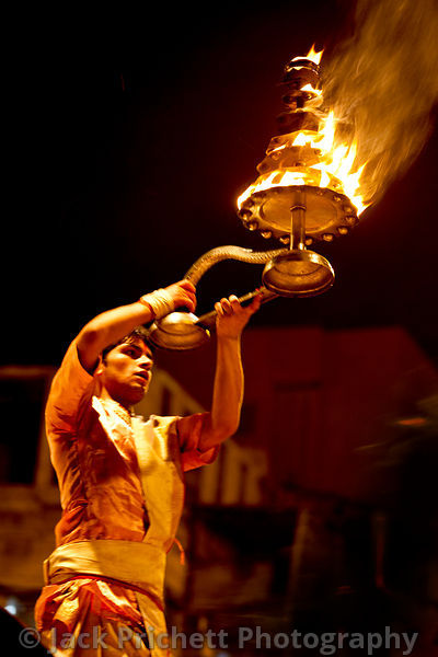 Hindu priest with flaming torch