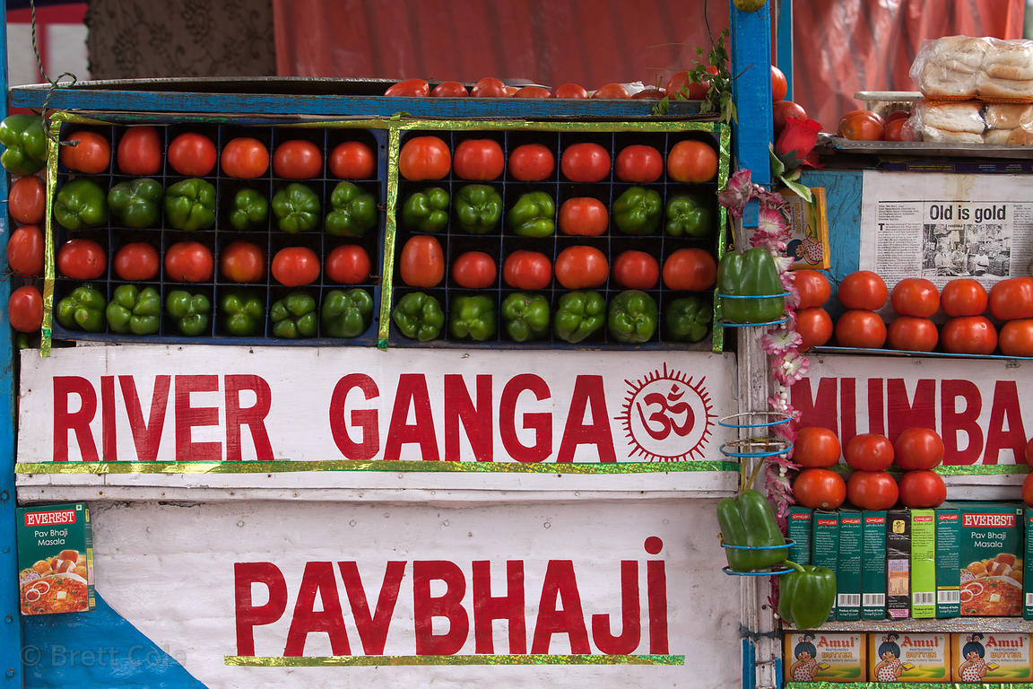 Tomatoes and green peppers for sale at a market at Princep Ghat, Kolkata, India.