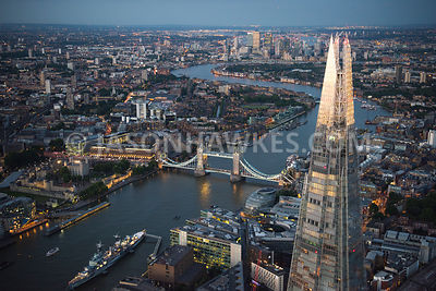 Aerial view of London, The Shard towards Docklands at night.