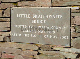 A plaque on the new stone bridge over Newlands Beck at Little Braithwaite in the English Lake District after the floods of 20...