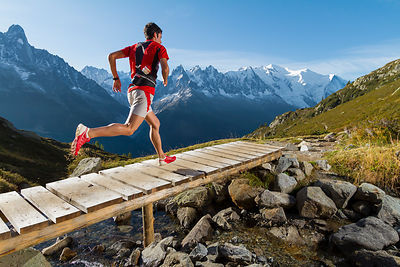 Across the wooden bridge with Kilian Jornet