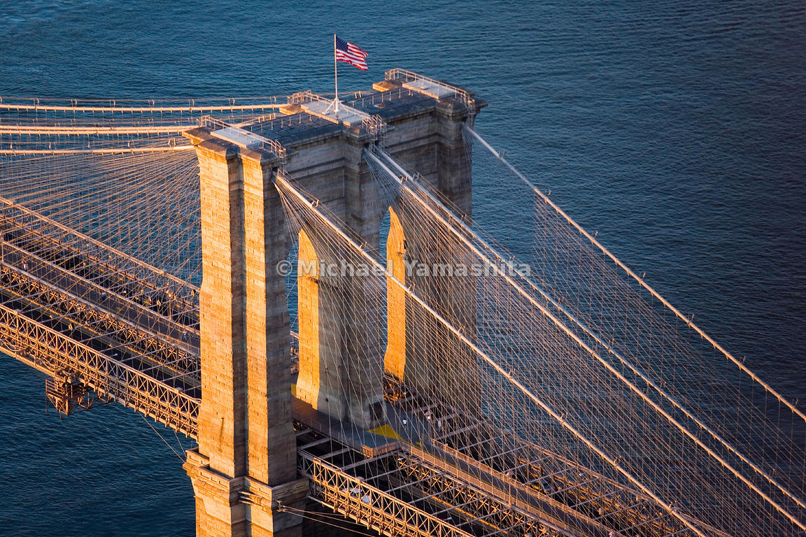 Immediately after the 9/11/2001 terrorist attacks, we see the American flag waving high on top of the Brooklyn Bridge.  New Y...