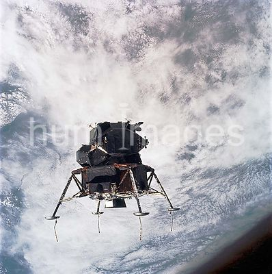 7 March 1969- Apollo 9 Lunar Module, Spider, in a lunar landing configuration, as photographed from the Command and Service M...