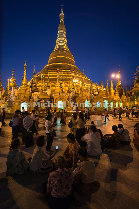 Locals gather on the main concourse of Shwedagon Pagoda after nightfall. The pagoda is considered Myanmar's greatest treasure...