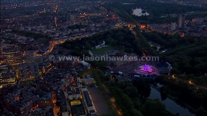 Aerial footage over Buckingham Palace at night, Westminster, London, England, UK