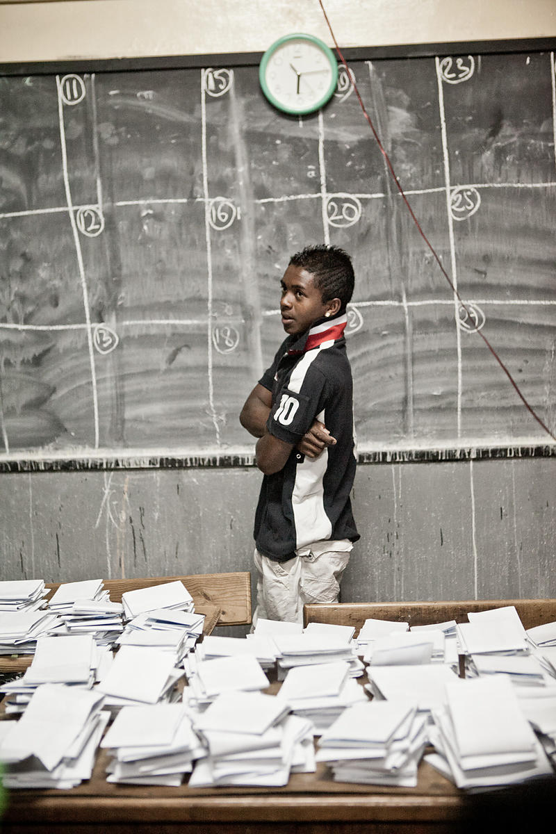 A Madagascan youth waits to mark votes on the board at a polling station in Antananarivo on October 25, 2013. Madagascar vote...