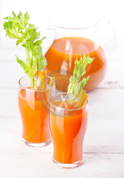 Fresh carrot and pumpkin juice on white background