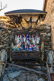 Old Liquor Bottles in a Buggy in Belmont, Nevada