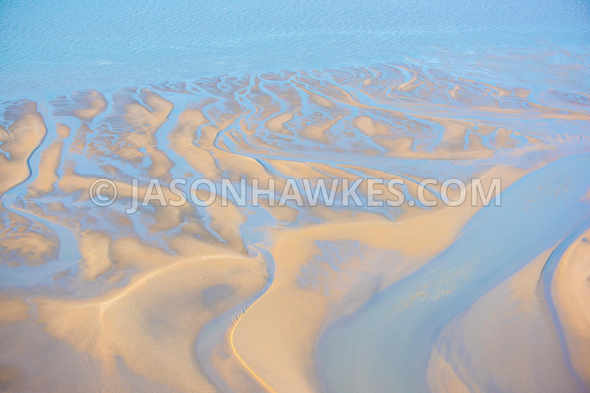 Aerial view of patterns in the sand on a beach in North Wales