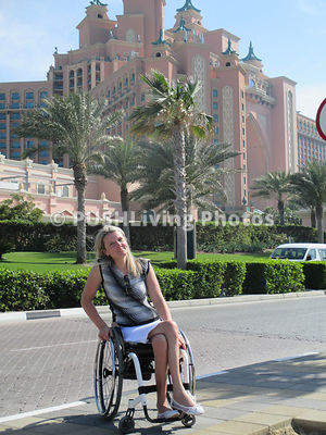 Young woman traveler using a wheelchair visiting Dubai
