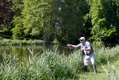 Fly fisherman casting line