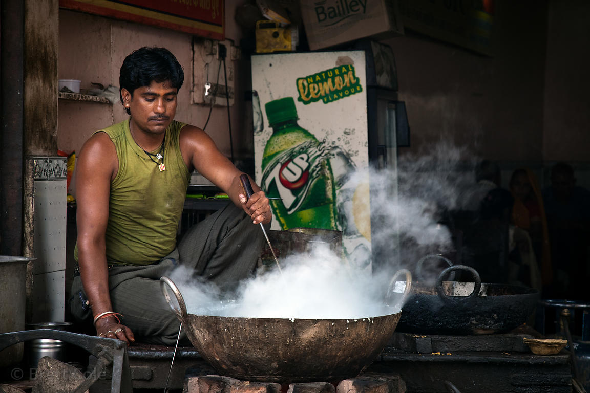 A man stirs a wok in Jaipur, Rajasthan, India
