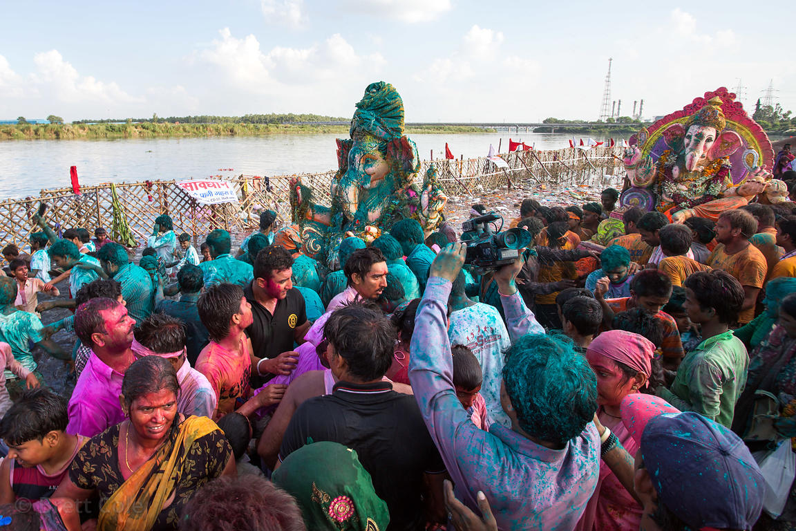 Families immerse idols of Ganesh in the Yamuna River during the Ganesh Chaturthi festival in Delhi, India