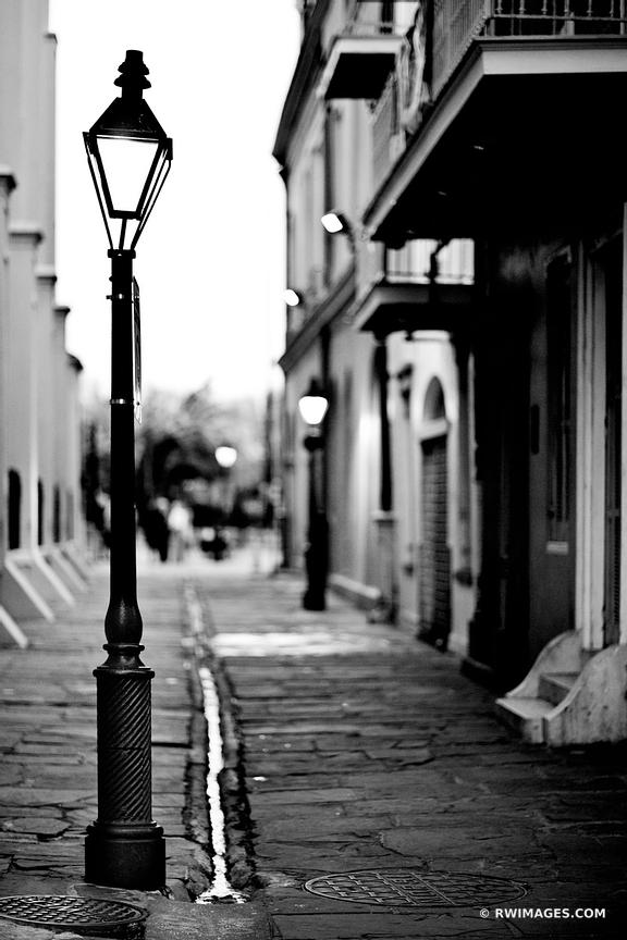 PIRATES ALLEY FRENCH QUARTER NEW ORLEANS BLACK AND WHITE VERTICAL