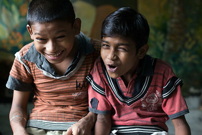 Two friends joke around at a shelter for homeless or otherwise at-risk boys at Sealdah Station, Kolkata, India