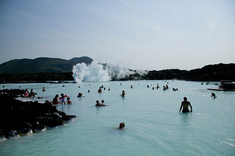Bathers swim in blue lagoon, Iceland