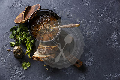 Traditional Georgian soup Kharcho with lamb meat and rice on dark background copy space
