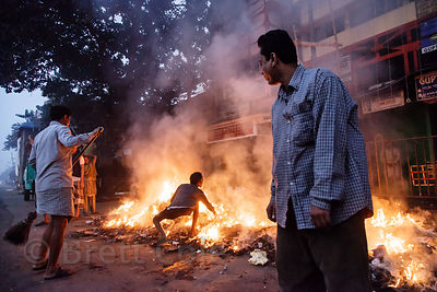 Scrap metal is burned at a taxi cab repair facility near Ballygunge, Kolkata, India. Such fires contribute to the terrible ai...