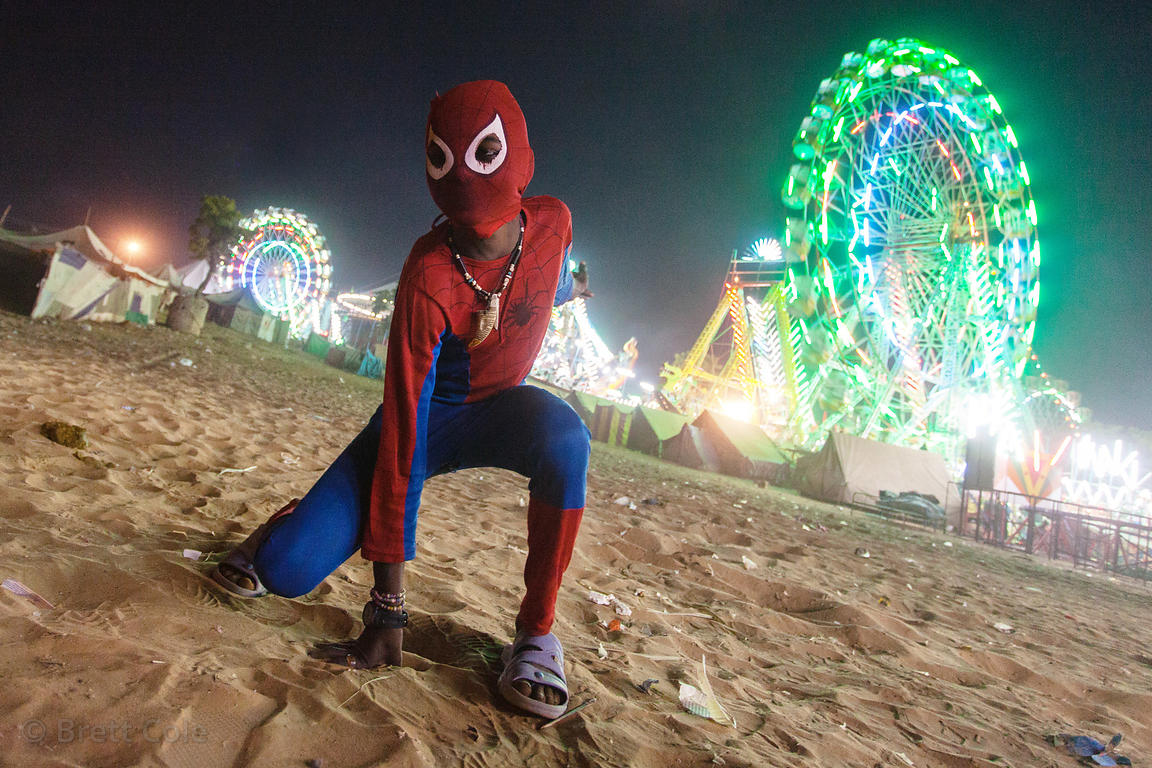 A boy dressed as Spider-Man at a carnival in Pushkar, Rajasthan, India.