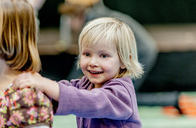 Little Nordic girl dancing in a conga