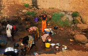 People washing clothes in the river in Kibidwe district, the old part of town, Bobo-Dioulasso, Burkina Faso