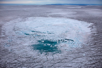 Aerial view of meltwater lake with collapsed ice cover on ice cap north-east of Sermeq Kujalleq Glacier, Ilulissat Icefjord U...