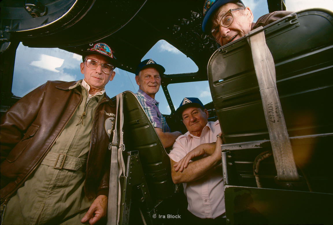 Veterans inside the cockpit of Nine-O-Nine.