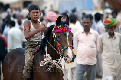 Boy riding his horse at the 2010 Pushkar camel fair, Rajasthan, India