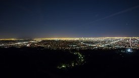 Bird's Eye: Vastness - Borders of Mountain Ridges & Civilization At Night (Pan)