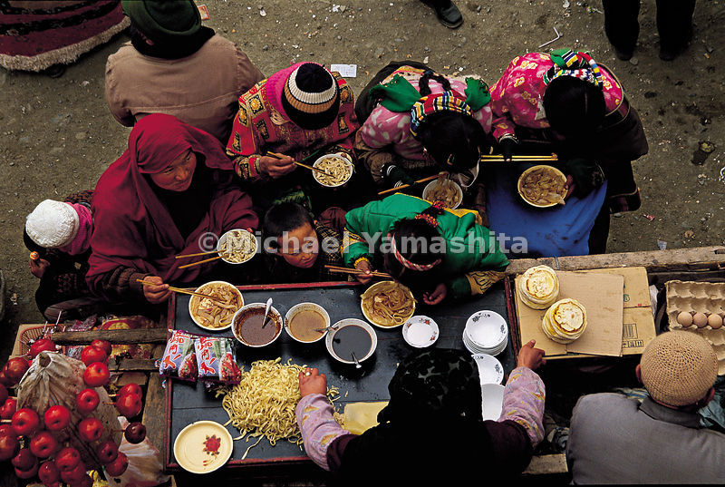 Outside the Labrang monastery in Tibet, many food stands sell sunflower seed, soya beans and noodles.
