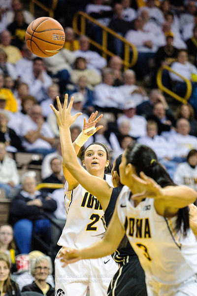 Iowa's Aly Disterhoft (2) passes to teammate Claire Till (3) against Purdue during the second half of play at Carver-Hawkeye ...